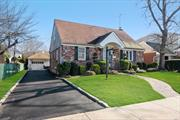 Cape in Manor Section of New Hyde Park. Home features 3 Bedrooms, Large Living Room, Formal Dining Room, Eat in Kitchen, Den with Fireplace, 1 Full Bath, Finished basement, Gas Heating, Central Air Conditioning, Sprinkler System. New Hyde Park SD#5 - Lot 55 X 100 - Close to All
