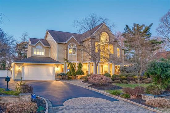 Gorgeous 6600 Square Foot Home In Percy Williams Cove On The South Shore Of Long Island. 6 Bed/4.55 Bath Colonial. 3 Fireplaces, 34' Ceiling In Living Room, and Large EIK With Butler's Pantry And Built In Wine Rack. Includes The Spacious +/-1200 Sqft Guest Suite On 1st Floor Which Features Private Front Entrance And Sliders To Resort-Like Backyard With In-Ground Pool, Patio, And Cabana. **Part Of A Waterfront Community Which Includes Access To Private Marina With Docking And Tennis Court.**