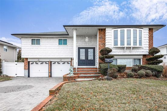 Beautiful Wideline Hi Ranch in Massapequa Shores whch includes Spacious Living Room, Updated Eat in Kitchen with granite countertops, Solid Wood Maple Cabinets and ceramic floors, Hardwood floors, Master Bedroom w full Bath, Large Family Rm, Dual Entry Staircase, Jacuzzi Bath, , Beautiful Backyard with Pavers and Semi-Inground Pool (26x16) Hot Tub, PVC Fencing!!