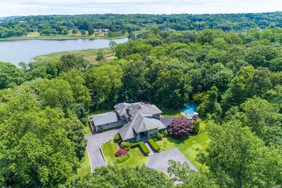 Spacious 6 Bedroom Post Modern Home With Comfortable Living For Extended Family. Open Concept Layout Surrounded By Lush Landscaping And Ig Gunite Heated Pool With 3 Decks And Bluestone Patio Plus 4 Car Garage.