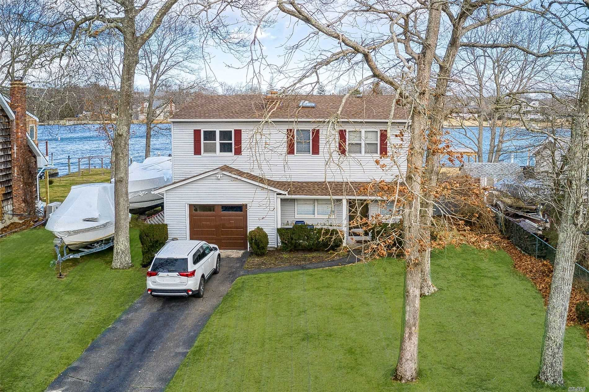 This Amazing Waterfront Home in Desirable Holiday Beach Commnity is Waiting for You! Features Include: Bright and airy Liv Rm w/fireplace, EIK, FDR, Den, Large Master Bedroom, 3 Additional Bedrooms, 1.5 Car Garage, New Roof, flashing and garage door, Updated Heating System 75 Feet of Bulkhead with electric and water at dock. Deeded Beach and Boating, Clubhouse. Great location. Call Today!