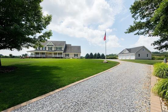 Calling All Car Collectors, Horse Enthusiasts, Artists, or People who Love To Relax In The Privacy Of Their Own Property! This 5-6 Bedroom Home With 6 Car Garage is Waiting For You! Everything Is Custom Built, Kitchen, Floors, Woodwork Throughout, Wrap Around Deck. This Home Has Been Built To Replicate A Farmhouse Inside and Out! The Property is Cleared and Professionally Landscaped. Its like Living In A Sanctuary. Possible Bed and Breakfast With Proper Permits. Close To The Beach.