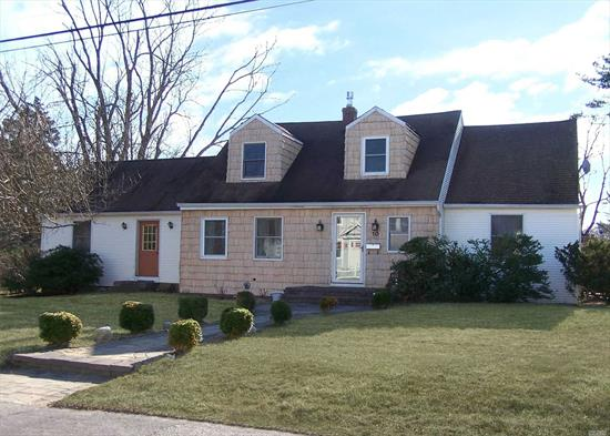 Expanded Cape in So. Blue Point on 1/2 acre corner property 4 Bedroom, 2 Bath, Possible M/D.  Formal Dining Room, Living Room with gas stove, sun room off Eat in Kitchen,  Master on 1st floor,  full basement, large shed, great potential.