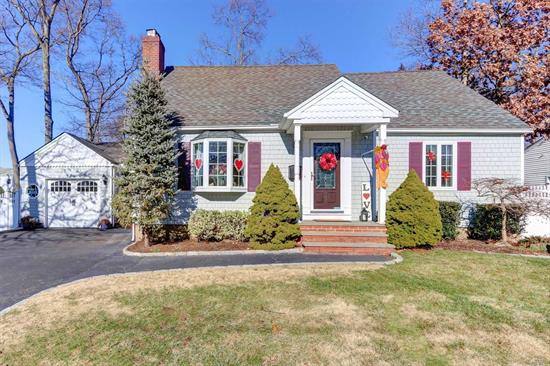 The Home you been waiting for.Classic 4br Cape in the heart of Massapequa Woods.This Charming home sits on a beautiful 80x100 ppty in sd#23.Living rm with fireplace, Enclosed breezeway/vaulted ceiling off Dining area.Updated Baths, Rear dormer. Fin Basement, Oversized driveway 4 a/c units , 1 Ductless unit in fin. basement .Great area close to railroad, Low taxes of $8901. with basic star!