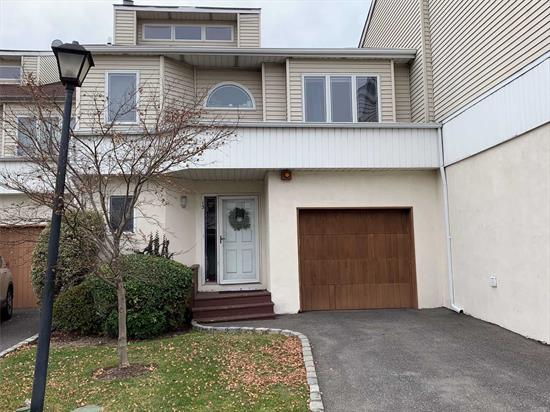 Beautiful Townhouse Eat in Kitchen, sliding doors to backyard,  Living Room, Dining Room w/ Cathedral ceilings, Laundry Room w/ W/D, 1/2 Bath, Up- Master Bedroom Suite w/ full Bath (Stall Shower) skylight,  closets, Deck off MB, Bedroom, Bedroom, Full Bath, Full finished basement (2 Rooms), 1 Car Garage w/ Driveway