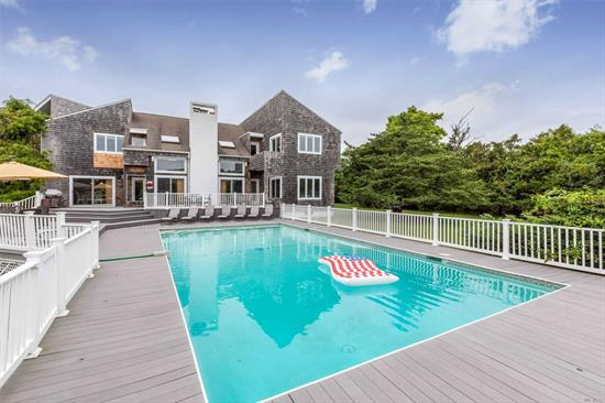 Lots Of Fun In The Sun For All Who Want To Share In Being Part Of The Westhampton Community. This Four Bedroom, Four-And-A-Half Bath 2 Level Contemporary Home Has Plenty Of Open Space, Heated Pool, Plus Dock For Small Watercraft, Finished Basement With Pool Table, Ping Pong, Media Room Plus Additional Bedroom. Enjoy Being In The Wide Open Spaces But Close Enough To The Village Of Westhampton Beach Offering Access To Rogers Beach, Restaurants, Theaters, Shopping, worship...Offered for the Season