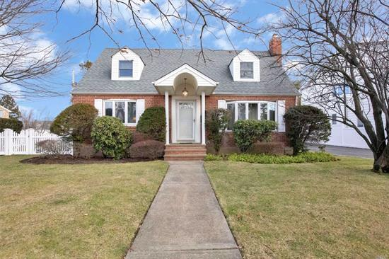 Beautiful Wide Center Hall Cape Located in Desirable Franklin Square. Currently used as a 4 Bedroom. Can easily be a 5 Bedroom, Office, 2 Full Bath, Eat-In Kitchen, Large Full Finished Basement, with Separate Laundry Room. Closets Galore,  Park Like Backyard, 2 Car Garage and Private Driveway, . Great Low Taxes!!!  A must see.