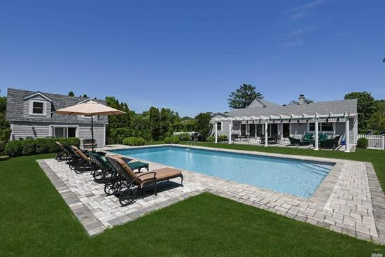 This Beautifully Renovated 4 Bedroom Home Is Located South Of Montauk Highway, On 1.27 Acre, It Provides An Oasis Of Tranquility. The 1st Floor Includes A Spacious Foyer Opening To The Living/ Dining Area, A Chef's Kitchen With Large Island, Three En suite Bedrooms And Powder Room. Second Floor Features A Spacious Master Suite. French Doors Open To An Expansive Entertaining Area W/ Pergola. Heated 20X40 Pool, Pool House W/Bath. Property Includes .5 Acre Rear Lot For Potential Tennis Court.