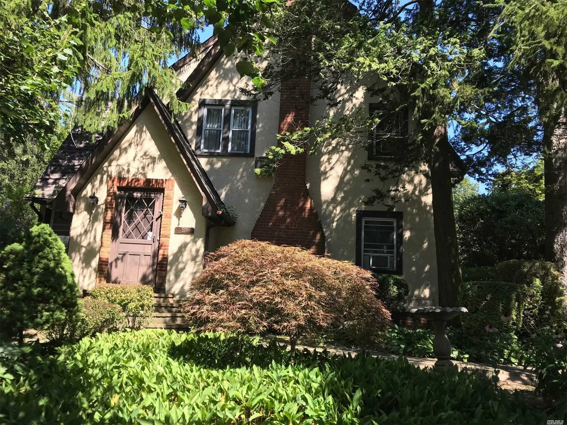 Charm & grace enhance the beautiful bones of this 3 BR Tudor. Large LR w/fireplace, spacious Eat-in-Kitchen and Formal Dining Room. Master Suite with dressing area and lots of closet space. Landscaped grounds. North Shore Schools, beach privileges. Don't miss this one!