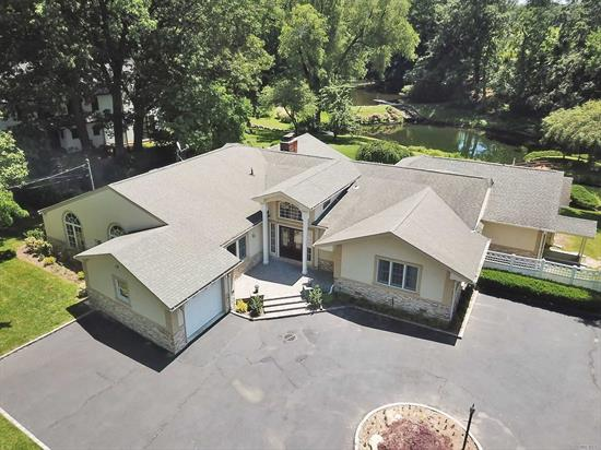 Magnificent property set on one of a kind picturesque property with pond views. Floor to ceiling glass walls overlooking the incredible year round views. Master suite is spacious with new master bath + walk-in closets + French doors leading to the outdoor patio. Option of North Shore or Roslyn School District. Rare Gem!
