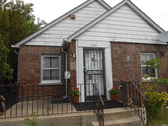2 Bedroom 1 Full Bathroom brick Cape sitting on large 50 x 100 fenced in property featuring full basement, gas utilities, 5 separate slim A/C//heating units, wood floors. enclosed heated rear porch Separate 1 car garage with private driveway. This home has a lot of storage and potential