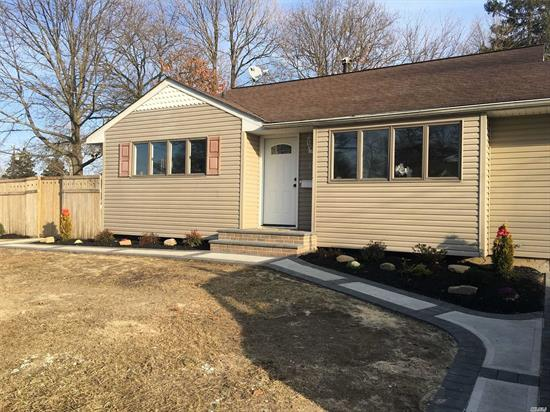 Nicely Renovated Split on a Big Side Lot. Located in Lindenhurst Village Close to LIRR and Shopping Stores. 4 Bedrooms, 2 Bathrooms, Hardwood Floors Throughout the House. Won't Last!