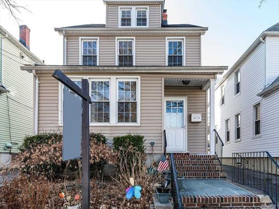 Beautiful Bayside Gem on picture perfect block - fully detached colonial on 30x100 lot with private driveway and garage. First floor: foyer, sun room, LR, formal dining room, bright eat in kitchen and half bath. The side entrance to the full unfinished basement is located by the stairs. The second floor has 3 full bedrooms and a big bathroom with a tub and as separate shower. The full floor attic is finished and can be used as a forth bedroom. Private fenced backyard.
