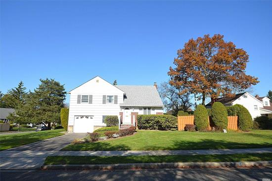MOVE IN READY 4 BR SPLIT --Priced W/Room To Modernize, 28' Lr/Dr w/ Entrance to Deck, Eat in Kitchen, Lower Level Den w/OSE, Laundry Rm, 1/2 Bath, Perfect for Home Office. Private Fenced Yard. Wood Floors Throughout, 2 year new roof, att garage.