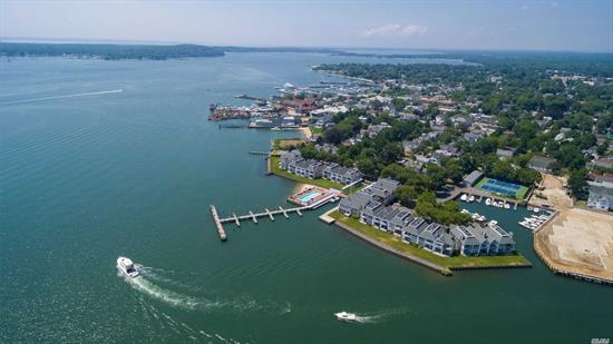 Recently upgraded townhouse condominium in coveted Stirling Cove, with beautiful Harbor & Bay views and deeded boat slip in protected marina. Complex has heated in-ground pool, private beach & two tennis courts, all located just a short walk to Greenport Village. The 2 bedroom, 2.5 bath unit has wood burning fireplace, newly upgraded kitchen,  renovated ground floor powder room, 2 ensuite bedrooms on second floor and full-time on-site management. Islands End golf course is just minutes away.