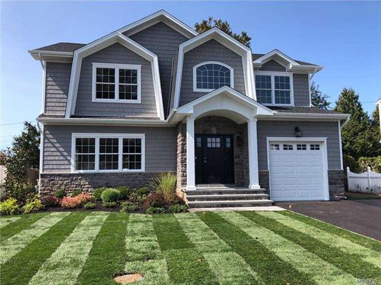 TO BE BUILT ~ 5 Bedroom, 3.5 Bath Colonial in Syosset School District. 2 Master bedroom suites! One spacious Master suite on 1st floor and another Oversized Master Suite on the 2nd floor makes this home perfect for extended family...Bright, open floor plan is perfect for entertaining! 9' Basement ceilings W/outside entrance