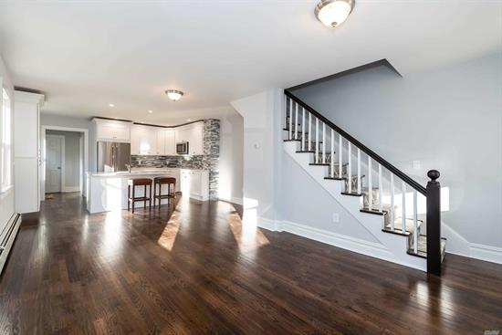 SIDE BY SIDE LARGE RENTAL. COMPLETELY RENVOATED! NEW EVERYTHING! RADIANT HEAT IN MASTER BATH, NEW APPLLIANCES, HARD WOOD FLOORS, WALK UP ATTIC AND LARGAE BASEMENT WITH WASHER/DRIER, WINE COOLER AND SMALL EXTRA FREEZOR.
