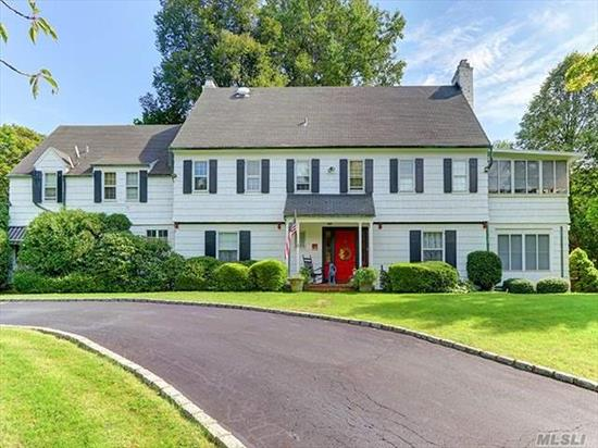 Welcome to this beautiful Circa 1900's Colonial with lots of history located on a cul de sac. This beauty delivers Dual Staircase, Master Bedroom Ensuite with Fireplace, Enclosed Porch w/Jacuzzi & Workout Area. 2 additional Ensuites plus 3 more Bedrooms. 4 Large Fireplaces, Servants Wing, Library & More. 2 Car Detached Garage with Loft, which was Chauffer's Quarters. Truly a must See. Privacy at its finest.