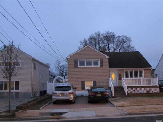 Beautifully updated split level home with low flood insurance.