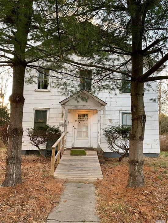 Rare opportunity to own L1 zoned property in Port Jefferson. The listing includes three lots totaling 5.91 acres. Includes a 7 bedroom, 1 bath house. Per the Town of Brookhaven, must be used for light industrial L1 use only.