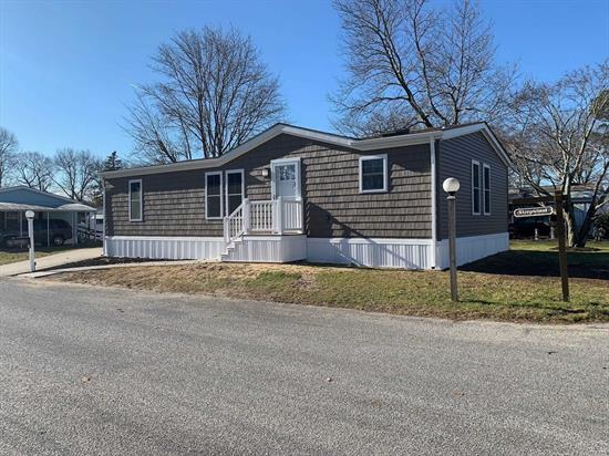 55+ MANUFACTURED HOME COMMUNITY - GLENWOOD VILLAGE - RENOVATED TOWNHOUSE MODEL - 2 BED, 2 BATH, SPACIOUS & OPEN LR, DR & KITCHEN AREA. SEPARATE UTILITY ROOM WITH LAUNDRY UNIT AND BACK DECK. SHED, CAC AND SPRINKLER SYSTEM!