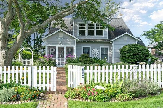 The picket fence and brick walkway leads you to this captivating waterfront retreat, right out of the pages of Coastal Living magazine. From the entry porch with english cutting gardens to the screened sleeping porch, covered waterside breakfast porch, the charm is in the details. The 2nd floor offers office space and ensuite master has tranquil views over the water . This coastal beach community is perfect for kayaking, days at the beach or lounging in the hammock. Offering includes 2 lots.