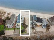 Coveted South Jamesport! This cottage sits right on a beautiful sandy beach, part of a colony of cottages with extra large lot. 34 feet of frontage and the most incredible panoramic views of Great Peconic Bay. Once in a lifetime opportunity to restore or build brand new!