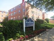Beautiful updated spacious unit in Desireable Crescent Building. Updated Kitchen, bath, freshly painted, new carpet, floors, fixtures. Move right in. Maintenance includes heat, gas, water, taxes. Does not reflect star deduction. Renovated laundry rms on each flr. Elevator, gym, community rm. This unit offers separate storage area. Located steps from RR. Near shopping, major highways, house of worship. Primo building in super location offering a turn key unit!!!!