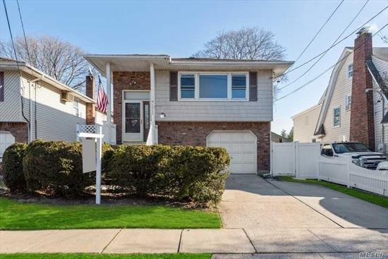 Fully renovated bright and spacious lovely 4/5 bdrm Hi/Ranch. Wood flrs, crown moldings, great size bdrms, 2 fl bths, open layout with fam rm, din rm, updated eik with island with granite counter tops, great appliances. Fully finished bsmt with fam rm, den,  bthrm, 2/ose, laundry rm, utility rm with updated boiler and hot water heater, updated electric, walk in closet, lrg pv yrd, oversized drive way & garage.