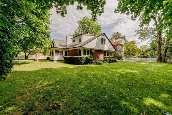 Beautiful and bright, spacious 5 bedroom brick expanded cape in the Weeks Woodland area of Bayside. Situated on a serene park-like setting; 100 x 122 lot on picturesque property! This updated and renovated home features large bedrooms, wood burning fireplace entertainers living room; formal dining room with wainscot; huge gourmet eat in kitchen with granite island which leads into great room overlooking Crocheron park. Sun drenched den or office space. Easy access to LIRR, buses, parkways.