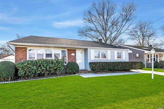 Absolutely Perfect! Beautifully Maintained Open Concept Home. New Roof, 3 Bedrooms, 1.5 Bath, Custom Kitchen w/ Granite Island and SS Appliances. Updated Windows, Central Air, 2.5 Detached Garage, 7-Zone Sprinklers, Nestled on Huge 60x200 Lot. Note: Bellmore School District (Kennedy HS).