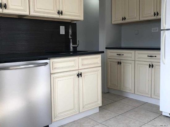 Updated Duplex. Apartment located on second floor with third floor loft. Newly Renovated. New Kitchen and Bathroom. Private Washer/Dryer in unit. Shared Yard. Close proximity to LIRR, Stores, and Oceanside School #2.