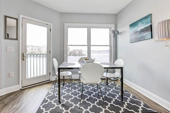 Come and see this beautiful 3 bedroom 2 bath home with a large brand new kitchen. Located in the highly desirable Promenade, this waterfront condo has spectacular NYC views.  The home consists of a large entry foyer, hardwood floors, and a brand new open kitchen layout with stainless steel appliances, granite counter tops and glass tile back splash over-looking the dining/living area and working fireplace. Generous master suite with large walk-in closet, master bath w/ jacuzzi tub, separate shower and dual sinks. w/d in unit. The balcony connects the master bedroom with the living area. The condo has direct access to the garage & gym. Includes 2 deeded parking spaces. Amenities are gym, community room, and hot tub. Pets are welcome! Walking distance to City Place, restaurants, shops, NYC transportation and more. Must see!