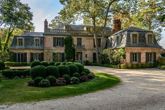 Long Driveway Leads To A Magnificent 19 Room French Provincial Home With A Mansard Slate Roof, 11'Ceilings, 4 Fireplaces, Water View's Of Cold Spring Harbor With Western Exposure For Beautiful Sunsets.A Separate 2Br Caretakers Cottage over 3 Car Garage, In Ground Heated Gunite Pool And Tennis Court.Beach And Mooring Rights To Eagle Dock W/Fee.Borders Trail View State Park.