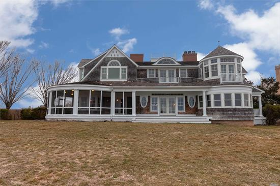 Beautifully Renovated Traditional Home with 4800 square feet of Living Space. Amazing Hardwood Floors throughout. 5 Bedrooms and 5 1/2 bath. IG Pool with Cabana. Situated on the Quogue Canal with Breathtaking Views. Large Chefs Kitchen with plenty of prep space,  Built -ins for added storage. 2 Car Attached Garage.