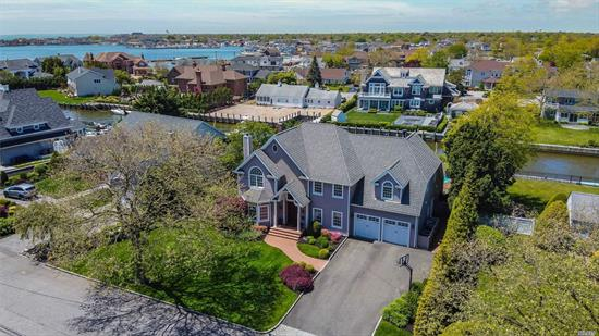 Magoun Landing Waterfront Spectacular Traditional home with approximately 5000 sq.ft of pure living. Four Houses From the Bay offers a view from the master bedroom. Dock your boat in the protected canal with 120'feet of bulkhead. Enjoy the beautiful Summer breezes and outdoor entertaining. Many amenities to enjoy. Come and tour this home today!