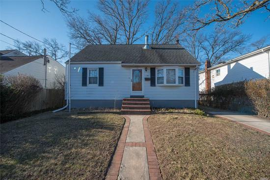 This Large Four Bedroom Home Sits On A Tree Lined Street. Newly Redone Floors In Living Room And Dining Room. Lots Of Room For Outdoor Entertaining. Close To Transportation And Center Of Town. Won't Last At This Price!