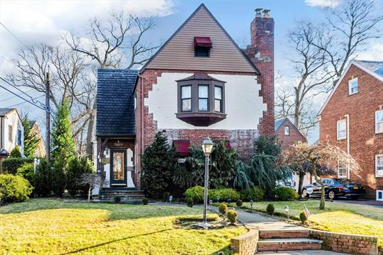 Charming Extra Large Parkwold Tudor with Banquet size Dining room, Hardwood floors thru out. New full baths, updated kitchen, huge basement with high ceilings, bath, wet bar & OSE. 2 Zone heat & CAC. Full walk up finished attic. 2 car garage. Taxes have never been grieved and in process.