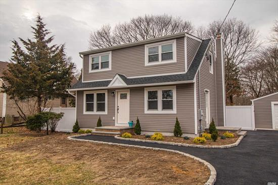 Brand new everything! Finished basement with over sized garage! New walkways, driveways, kitchen, floors, appliances, everything! West Islip Schools. Perfect backyard with beautiful pool for summer!