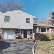 Beautiful 3 Bedroom Split On Cul-De-Sac In Desirable Half Hollow Hills SD. Living Room With Fire Place, Lovely Formal Dining Room, Family Room, and Eat In Kitchen. Spacious and Quiet Backyard For Entertaining. Across The Street From A Park And Close to Shopping. Must See!