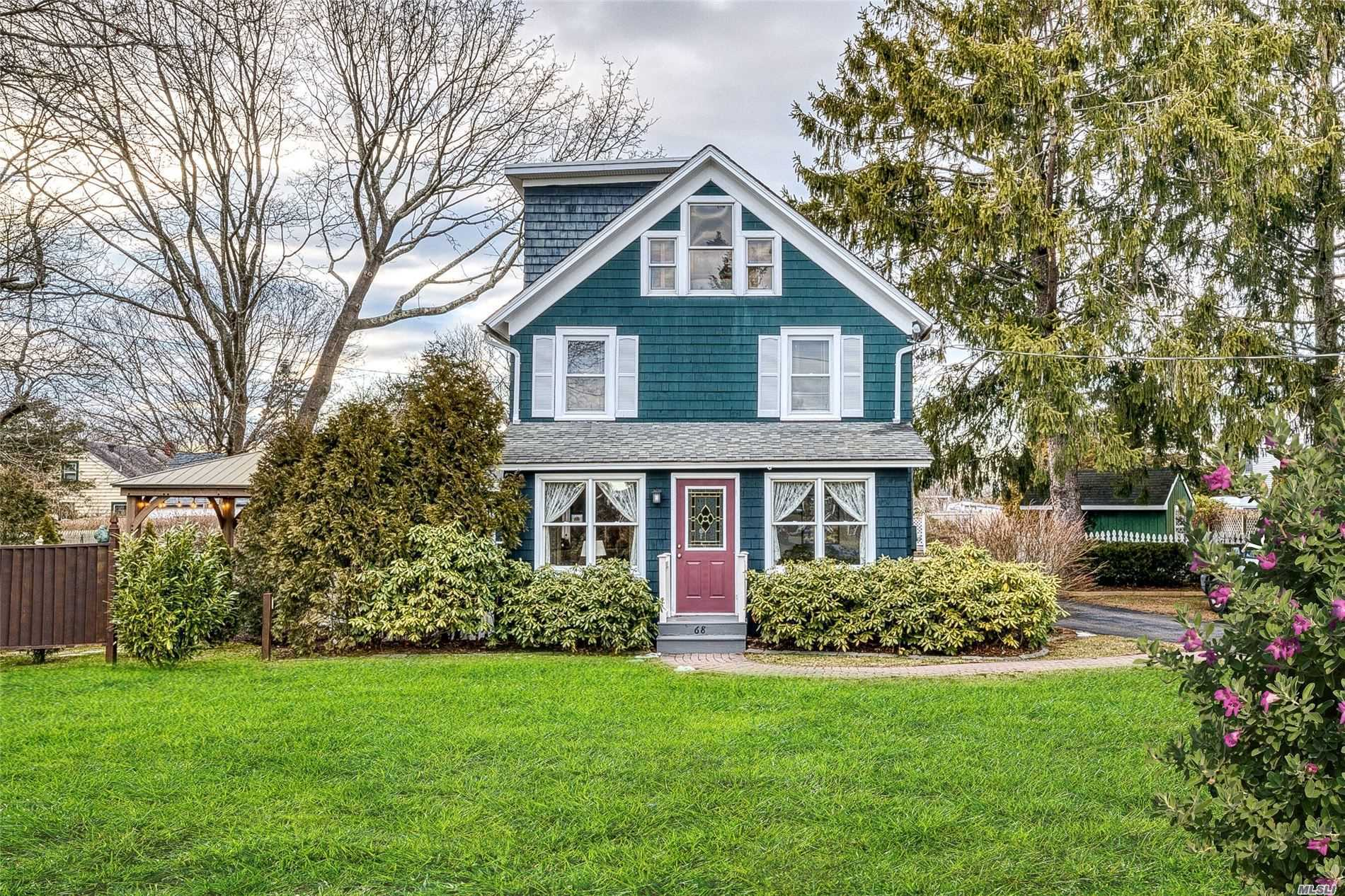 This Charming Home in The Heart of Center Moriches Has a Great Layout with lots of Natural Light. Features Include: Updated EIK, Heating System and Electric, Pine floors under most of the flooring in the house, Basement, In ground sprinklers, 4 Car Garage, Beautifully landscaped yard. Close to town, shopping, restaurants, beaches. Call Today!!!