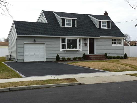 A classic style dormered cape cod in Massapequa Park with new paved streets. Newly renovated with modern functionality and masterfully crafted includes a Sleek New Kitchen w/isle, granite, ss applcs, 2 New Baths, 4 bedrooms, new siding, roof, 200 amp electric, A/C, in-ground sprinklers, solid core doors and much more. A Must See!!!