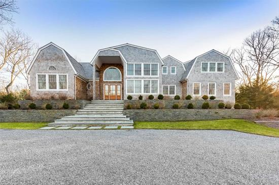 Water Mill New Construction. Magnificent new Water Mill home w/ 7 BR, 9 full & 3 half baths set high on 1 acre, 6, 700 sf + 3, 300 addtl sf in fin LL. Spacious, light-filled, open 1st flr living areas: great rm & LR w/ 10' ceilings, 2-story dining rm w/ windows on 2 levels, top of line eat-in chef's kit w/lg marble island. 2 luxurious masters 1st & 2nd flrs. All beds & baths beautifully finished & appointed. Spacious terrace, htd gunite pool, spa, outdoor kit.