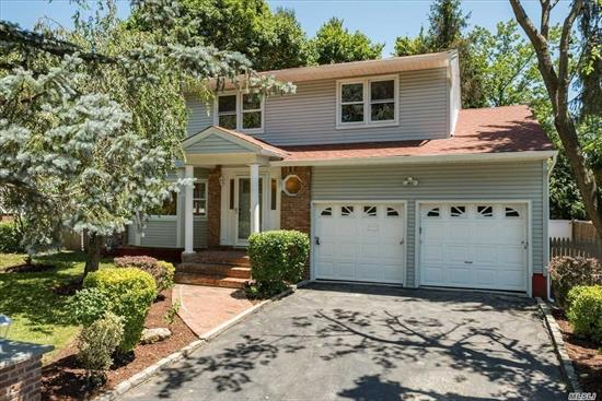 Fully Renovated Colonial featuring Formal Living Room, Formal Dining Room, with Stainless Steel Appliances, grantie countertops, ceramic flooring, Family room with Fireplace, Master Suite with Jacuzzi, 3.5 Baths. Full Finished Basement, 2 Attached Garage.