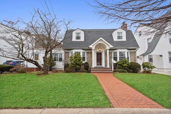 Magnificent 1, 916 sq ft 4 bedroom, 2.5 bathroom colonial home in Lynbrook. This home has a 1st floor master bedroom w/ full bath, office, enclosed finished porch, updated EIK w/ stainless steel appliances, granite counter tops, spacious living room w/ fireplace, 3 large bedrooms, full finished basement w/ additional room, den & workshop. Long driveway w/ detached 2 car garage & large enclosed backyard w/ pavered patio. Close to LIRR, & shops. See Link For 3D virtual tour. TAXES BEING GRIEVED.