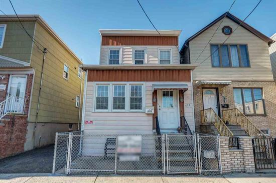 Lovely, Clean And Well Maintained Single Family Home In One Of The Nicest Areas Of Bayonne. This Home Comes With Hardwood Floors As Well As A Heated Sunporch In The Front And A Closed In Back Porch In The Rear Of The House. Parking For Three Plus Cars Gives You The Option Of Renting Spaces Out For Additional Income. Ideal Starter Home Or Condo Alternative!