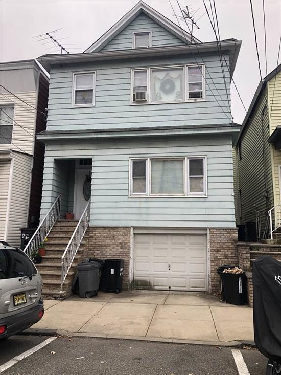 Looking for a 2 family in Bayonne to purchase, this is the one you should be considering. Conveniently located near the Light Rail, 2 bus lines on corner, 2 grammar schools, a playground and basketball court in the area as well as several popular convenience stores, in addition the home has 6 bedrooms and 3 full baths. 2nd apt is a duplex with 3rd floor. Owner has recently installed 2 new gas heating systems and 2 hot water heaters for your use. There is a W/D hook-up for each apt., in the basement and very important garage parking. Put your own spin on this home for you to enjoy with your family or use as an investment. Call to make appointment before it's gone.