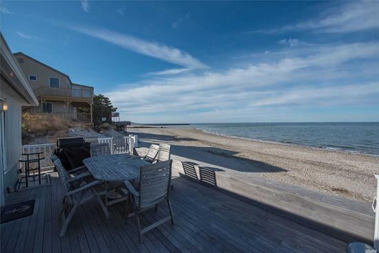 Adorable and totally updated beachfront home.Built for leisurely living. Walkout onto your own beach. Watch the sunsets, go swimming, kayaking, surfing! New Kitchen with Stainless steel appliances.  very tastefully done. Ipe Decking, outdoor shower, Built to enjoy life. Move right in