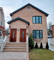 Beautiful brick detached 2 family rebuilt 2017 featuring gorgeous high end finishes, hardwood floors, custom tiles, 6 bedrooms, bonus attic room, detached garage, large backyard, 10 ft wide driveway, separate basement entrance, many green energy features, 1 block from Browne Park, 7 minutes drive to downtown Flushing, quiet residential block and much much more. Must see to appreciate details and extras!
