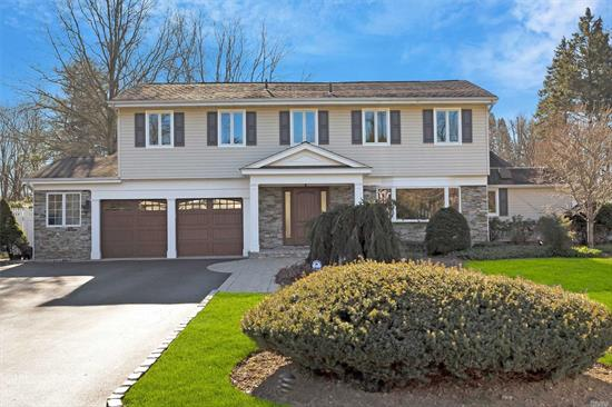 Perfect Location In Beautiful N. Syosset Neighborhood.Expanded 4 Bedroom, 2.5 Bath Splanch on Parklike Property with Gunite Pool and Speciman Plantings. Updated Kitchen With Wood Cabinets, Granite Countertops & Stainless Appliances Opens To an Oversized Family Room Offering a Great Flow for Entertaining. Master Bedroom Suite With Two Large WICs, Spacious Formal DR, LR on Separate Level w/Fireplace. Sound System Throughout, Laundry on Main Level. 2-car garage. Berry Hill Elementary. A Must See!